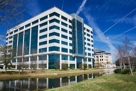 building exterior: multi-story modern office building along the Riverwalk in Jacksonville, Florida