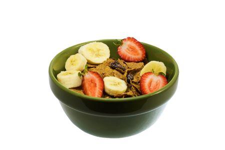 bowl of fresh strawberries, bannanas, and raisin on bran flakes isolated on white Stok Fotoğraf