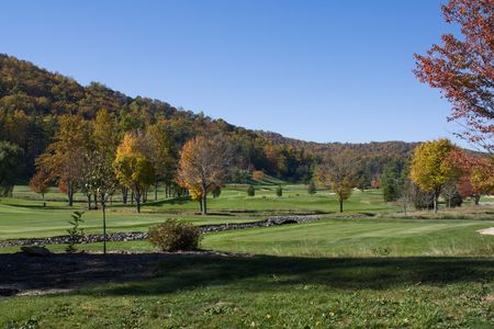 colorful mountain view golfcourse at autumn