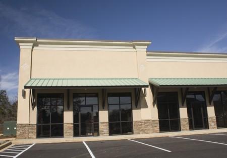 beige storefront building on a sloped lot Imagens - 4228933