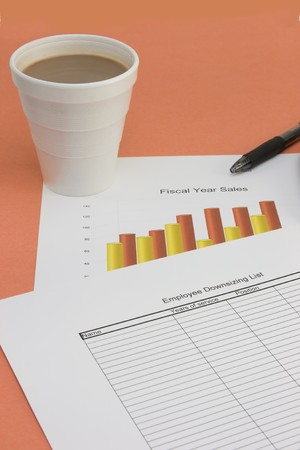 downsizing: downsizing list with sales chart and coffee