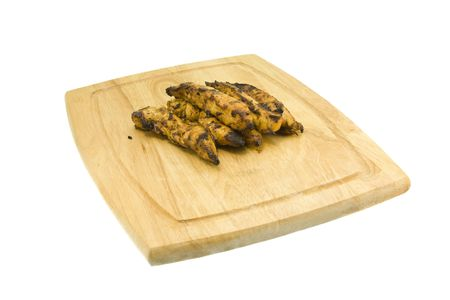 grilled chicken strips hot off the grill on white Banque d'images