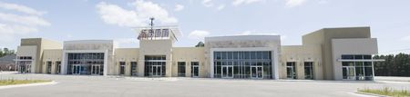 commercial real estate: stitched panoramic of an earthtone strip mall Stock Photo