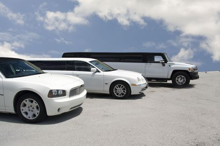 limo: row of three limousines on a blue sky