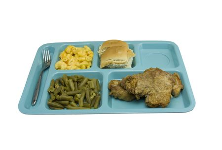 fried pork chop with macaroni and cheese, green beans, and roll on a blue cafeteria tray