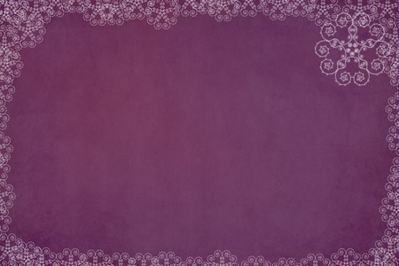 Christmas snowflake border on a purple grunge background Фото со стока