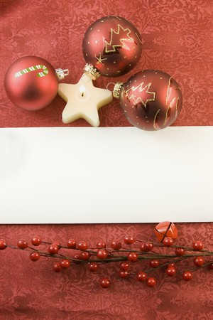 blank Christmas card with three red babules, star candle, red berries and copyspace
