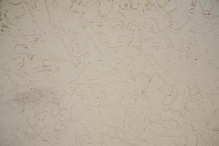 stucco: beige stucco wall