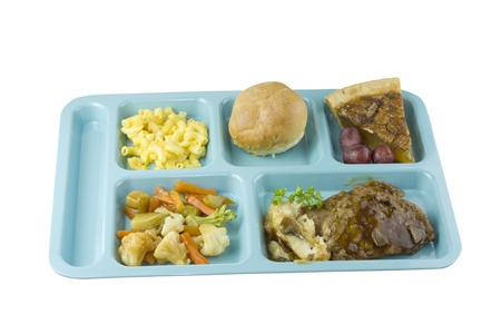 meat loaf cafeteria meal on white photo