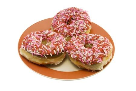 three sprinkled donuts