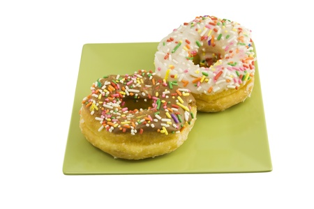two sprinkled doughnuts photo