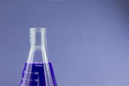 blue liquid in beaker Stock fotó