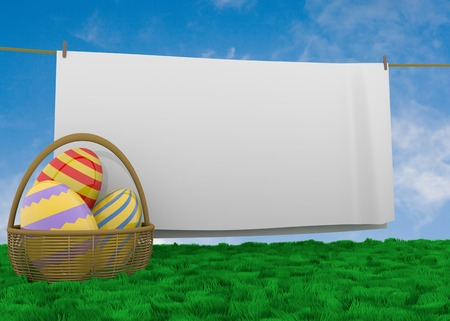Easter eggs in basket  lying in lush grass with white sheet hanging on a clothesline with space for your text
