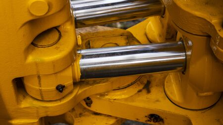 twin hydraulic cylinder detail on a new construction tractor Stock fotó