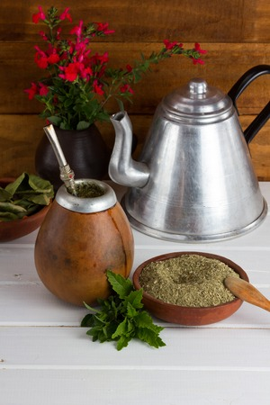 yerba mate: Yerba mate traditional tea popular in latin america sirved on the wooden selective focus