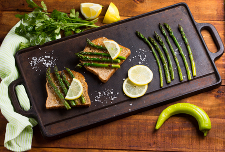 Asparagus sandwiches on cast iron table for frying
