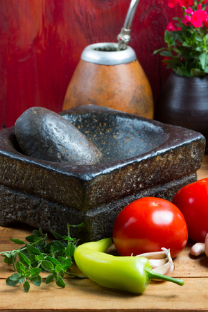 ingridients: Ingridients for traditional latin american tomato sauce prepared in stone