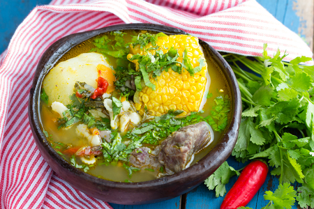 cazuela: Latinamerican food. Cazuela - traditional chilean latinamerican soup served in clay plate from pomaire