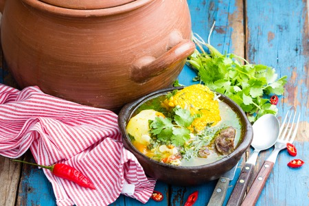 latinamerican: Latinamerican food. Cazuela - traditional chilean latinamerican soup served in clay plate from pomaire