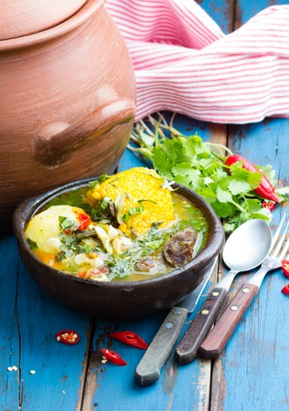 sopa: Latinamerican food. Cazuela - traditional chilean latinamerican soup served in clay plate from pomaire