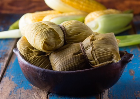 Latin American food. Traditional homemade humitas of corn and leaves Stock Photo