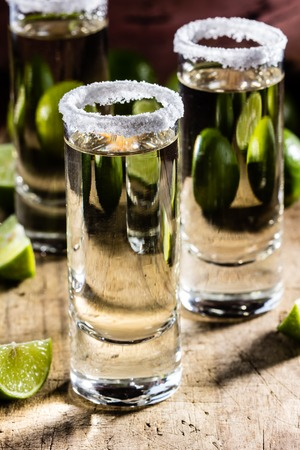 Mexican tequila. Tequila shot with lemon lime and sea salt. selective focus Stock Photo