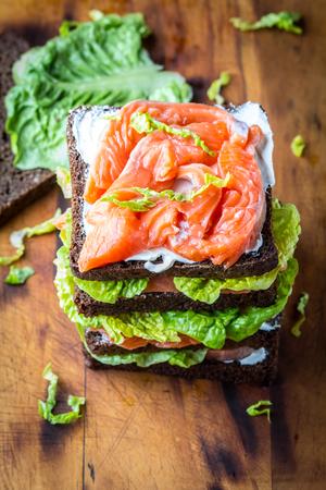 wholegrain mustard: Sandwich with salmon, lettuce, cream cheese Stock Photo