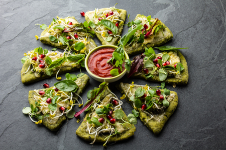 berro: Green spinach dough, vegetables and cheese pizza, slate background