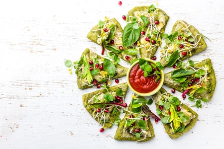 berro: Green spinach dough, vegetables and cheese pizza on wite background