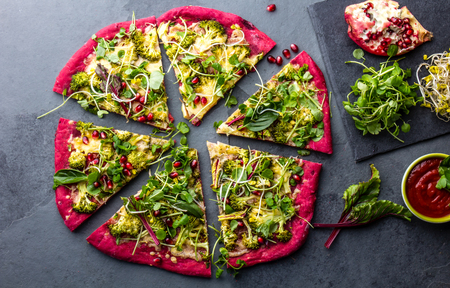 Purple beetroot dough, vegetables and sprouis pizza, Healthy fast food on slate Stock Photo