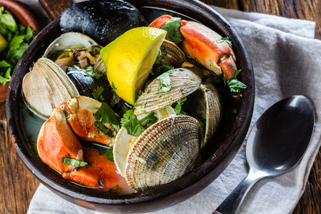 Seafood clams crabs mussela soup. Mariscal in clay bowls Stock Photo