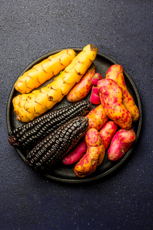 Peruvian raw ingredients for cooking black corn and sweet potatoes Stock Photo