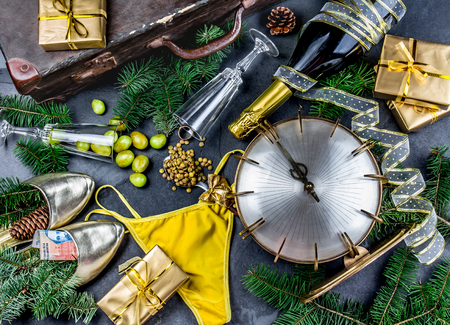 LATIN AMERICAN AND SPANISH NEW YEAR TRADITIONS. empty suitcase, lentil spoon, yellow interior clothes, gold ring in champagne, 12 grapes, money in shoe - ARGENTINE MONEY.
