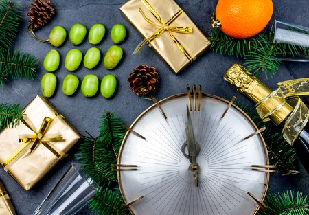 NEW YEAR TRADITION. Latin American and Spanish New Year traditional. Funny ritual to eat twelve 12 grapes for good luck at midnigth. Flat lay, top view. Christmas New Year composition. Stock Photo