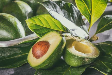 Fresh avocado with avocado tree leaves. Close up Stock Photo