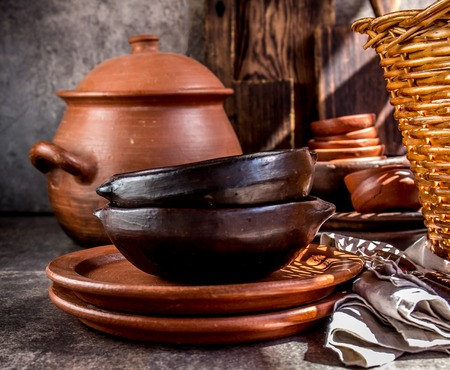 Clay rustic kitchenware - pot, bowls and plates from Chilean Pomaire. Stock Photo