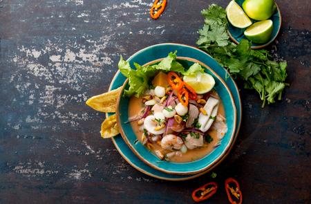 PERUVIAN CEVICHE SEBICHE. Peruvian seafood and fish sebiche with maize Archivio Fotografico