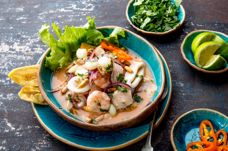 PERUVIAN CEVICHE SEBICHE. Peruvian seafood and fish sebiche with maize 免版税图像