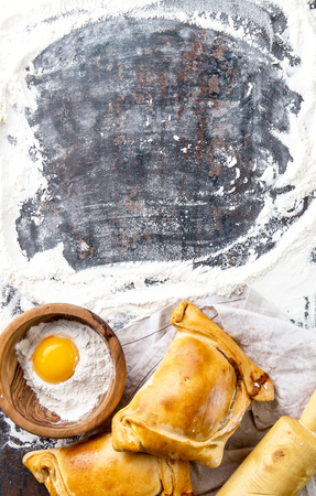 Chilean independence day baking concept. fiestas patrias. Chilean typical EMPANADAS DE PINO for independence day party. Copy space