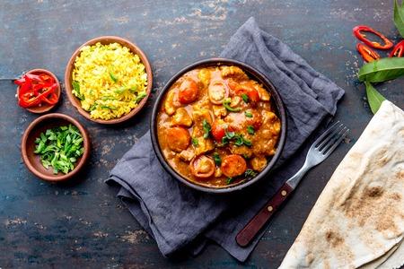 INDIAN FOOD. ROGAN JOSH curry sauce. Pork rogan josh with rice and naan bread.