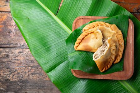 Easter Island Tuna empanadas on banana palm tree leaves. Top view.