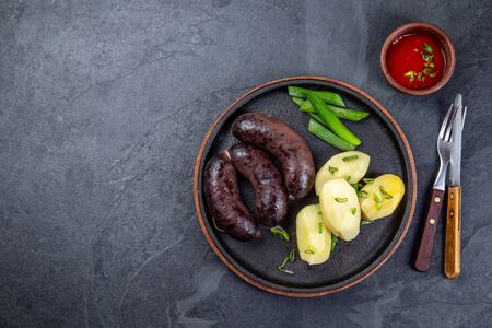Spanish and Argentine MORCILLA blood sausages with potatoes and chili sauce Standard-Bild