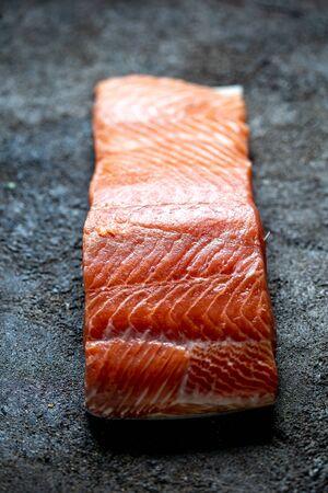 Food background with fresh salmon filet steak.