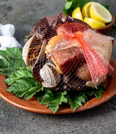Famous traditional dish of the south of Chile and the Chiloe archipelago - Curanto Kuranto.  Different seafood and meat cooked in a pit on the coals under the ground. 스톡 콘텐츠