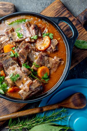 Bourguignon beef ribs stewed with onion, carrot in red wine. Top view