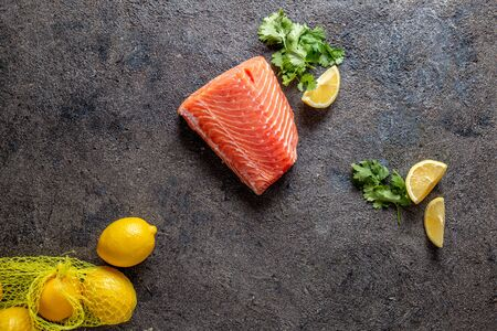 Food background with fresh salmon filet steak, lemon and coriander Stock fotó