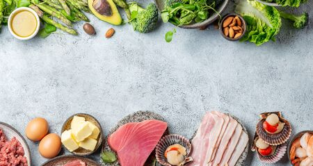 KETOGENIC DIET LOW CARB CONCEPT. Vegetarian and animal protein, carb and fat sources. Healthy food background with copy space. Foto de archivo - 130165684