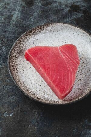 Raw fresh TUNA STEK on gray plate. Black background Stock fotó