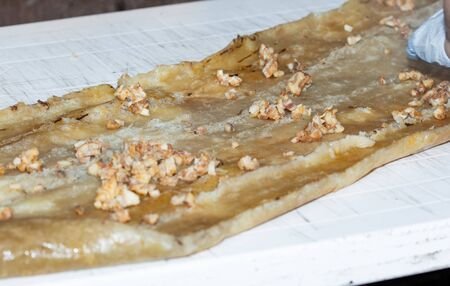 Preparation of CHOCHOCA - tpical food of Chiloe island, Chile. Chiilotan potato bread prepared on wooden stick.