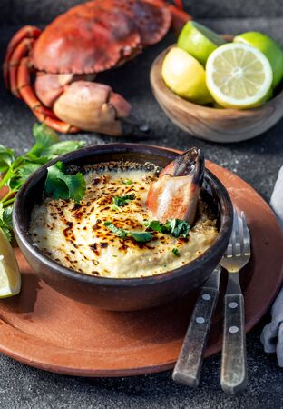 CHILEAN FOOD.  Baked crabmeat crab meat with cheese, cream and bread.  Traditional dish of chilean coast. Pastel o chupe de jaiba